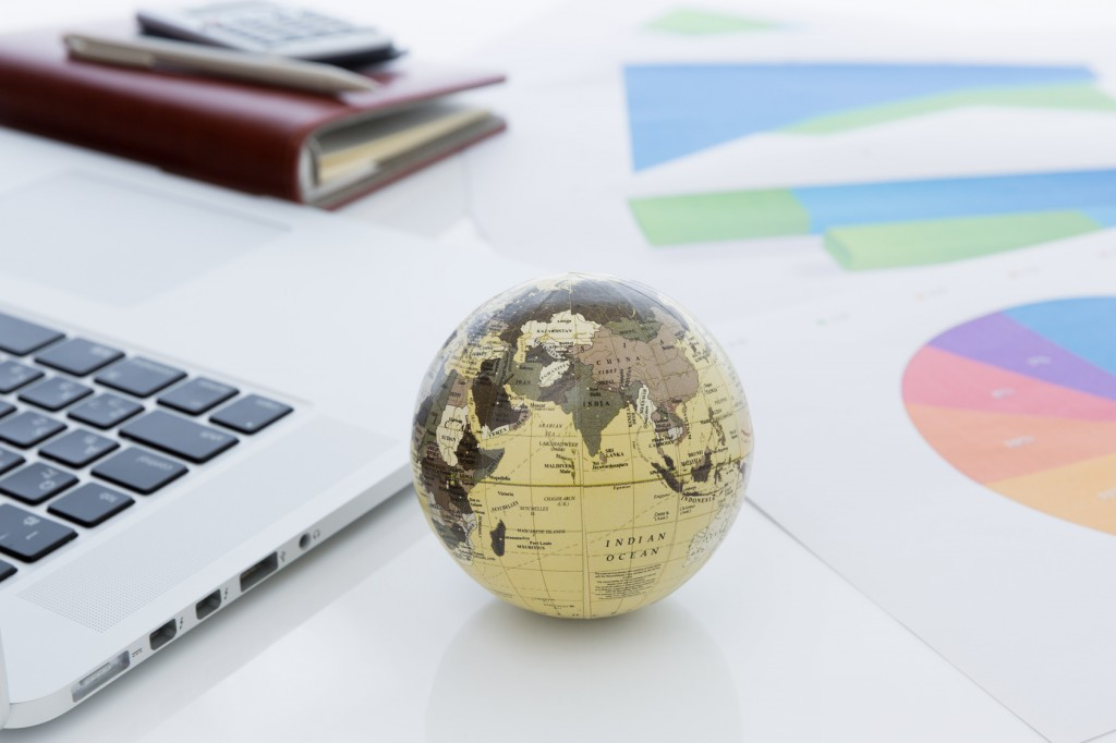 globe and business documents, terminology service is vital for international business